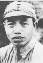 第六师师长谭震林