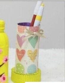 可以利用矿泉水瓶制作个漂亮的笔筒,独一无二.图片