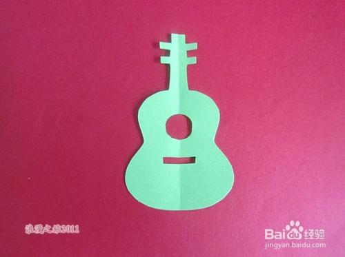 幼儿手工剪纸——六弦琴图片