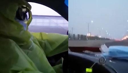 北京一的哥穿防护服开车