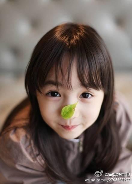 谁知道这个小美女叫什么?急