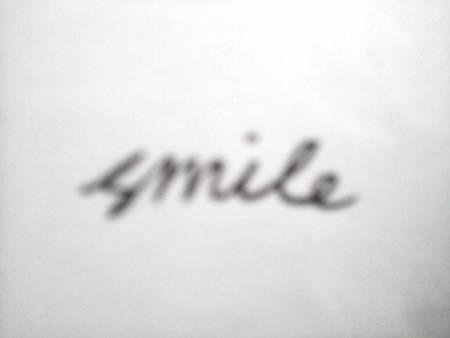 连笔英文smile怎么写?最好发个图图片